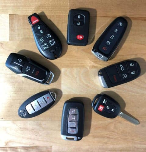 assorted automotive key fobs and remotes